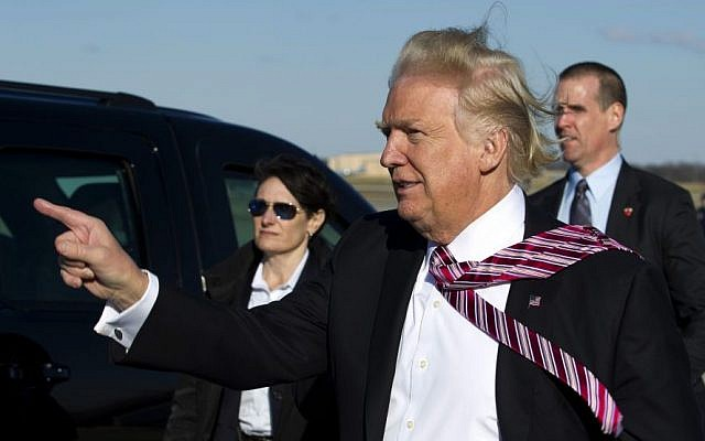 President Donald Trump points to guests upon his arrival at Andrews Air Force One, Md., Thursday, Jan. 26, 2017. Trump is returning from Philadelphia after speaking at the House and Senate GOP lawmakers at their annual policy retreat. ( AP/Jose Luis Magana)