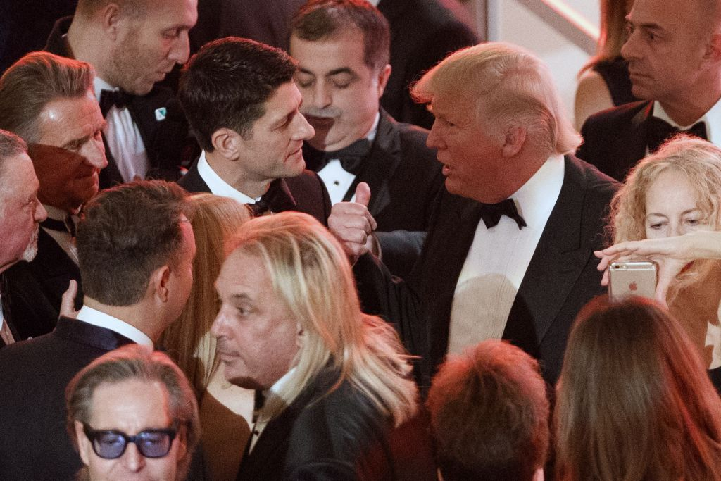 President-Elect Donald Trump talks with Speaker of the House Rep. Paul Ryan, R-Wis., during a VIP reception and dinner with donors in Washington, January 19, 2017. (AP/Evan Vucci)