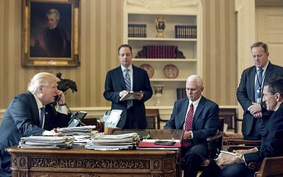 President Donald Trump, with Chief of Staff Reince Priebus, Vice President Mike Pence, White House press secretary Sean Spicer and National Security Adviser Michael Flynn, speaks on the phone with with Russian President Vladimir Putin, Saturday, Jan. 28, 2017, in the Oval Office at the White House in Washington. (AP Photo/Andrew Harnik)