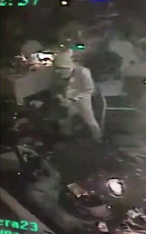 Screengrab showing the attacker carrying a gun as he walks through the Reina nightclub in Istanbul, January 1, 2017. (Haberturk Gazetesi Yildirim Ekspresi via AP)