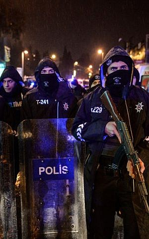 Turkish police officers block the road leading to the scene of an attack in Istanbul, January 1, 2017. (Depo Photos via AP)