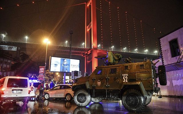 A police armored vehicle blocks the road leading to the scene of an gun attack in Istanbul, January 1, 2017. (AP)