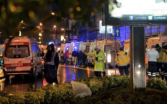 Medics and security officials work at the scene after an apparent terror attack at a popular nightclub in Istanbul, early Sunday, Jan. 1, 2017. (IHA via AP)