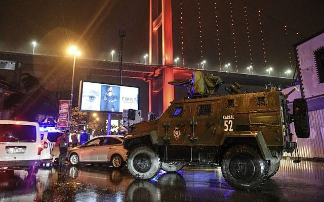 A police armored vehicle blocks the road leading to the scene of an apparent terror attack in Istanbul, early January 1, 2017. (AP Photo)