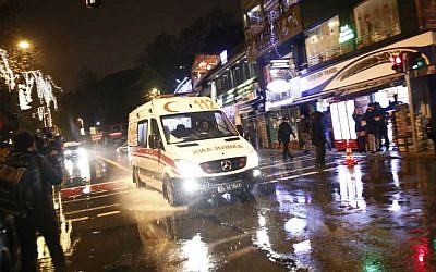 An ambulance rushes from the scene of a reported terror attack in Istanbul, early Sunday, Jan. 1, 2017. (AP Photo/Halit Onur Sandal)