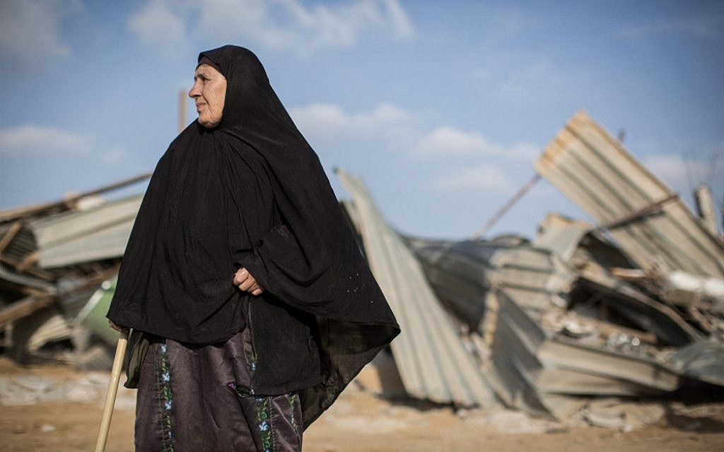 A Bedouin woman reacts after seeing her demolished home in the Bedouin village of Umm al-Hiran in the Negev Desert, in southern Israel, January 18, 2017. (Hadas Parush/Flash90)
