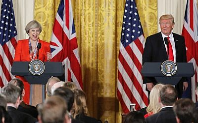 President Donald Trump and British Prime Minister Theresa May react to a question from a member of the media during their joint news conference in the East Room of the White House White House in Washington, Friday, Jan. 27, 2017. (Pablo Martinez Monsivais/AP)