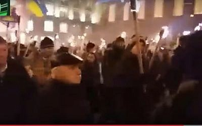 Screen capture from video showing Ukrainian nationalists in Kiev during a New Years Day march in which they chanted 'Jews out' in German, January 1, 2017. (screen capture: YouTube/FEDERAL AGENCY NEWS)