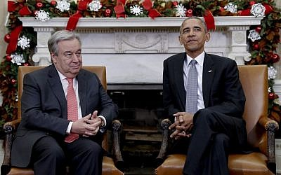 President Barack Obama pauses for media to take their places as he meets with United Nations Secretary-General-designate, Antonio Guterres, in the Oval Office of the White House, in Washington, December 2, 2016. (AP Photo/Carolyn Kaster)