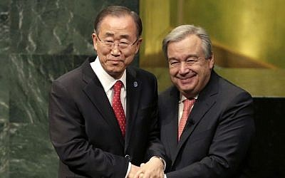 Outgoing United Nations Secretary-General Ban Ki-moon, left, clasps hands with UN Secretary-General designate Antonio Guterres after Guterres was sworn in at UN headquarters, Dec. 12, 2016. (AP Photo/Seth Wenig)