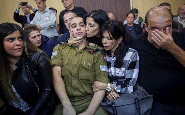 Elior Azaria, the Israeli soldier who shot a Palestinian terrorist in Hebron arrives to the court room before the announcement of his verdict, January 4, 2017 (Miriam Alster/Flash90)