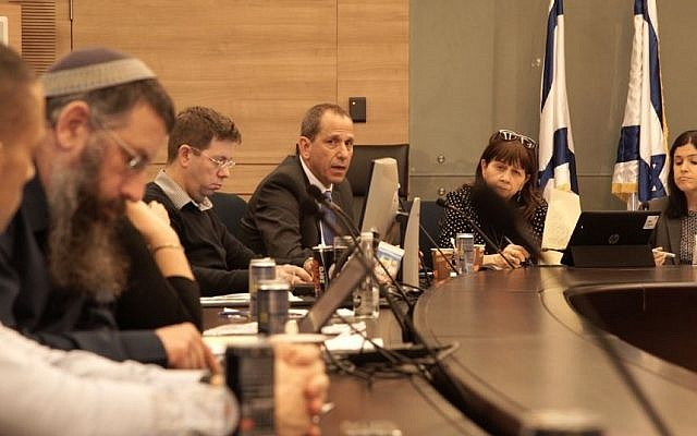 MK Karin Elharar, chair of the Knesset State Control Committee (right), Israeli Securities Authority chief Shmuel Hauser (third from right) and other participants in a session on tackling binary options fraud, January 2, 2017 (Luke Tress/ Times of Israel)