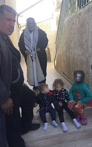 Relatives of Jerusalem terrorist Ibrahim Fadi al-Qunbar, in their home village of Jabel Muqabar, January 10, 2016 (Avi Issacharoff)