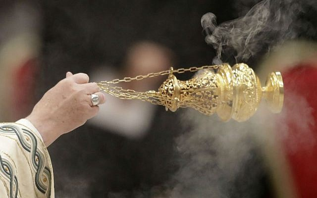 Pope Francis holds an incense burner as he celebrates a New Year's Eve vespers Mass in St. Peter's Basilica at the Vatican, Saturday, Dec. 31, 2016. (AP Photo/Andrew Medichini)