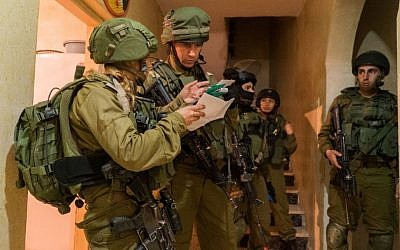 Illustrative: IDF troops make a late-night arrest in the West Bank on January 11, 2017. (IDF Spokesperson's Unit)