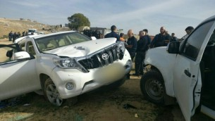 Israeli police stand next to a vehicle that rammed into police officers in the Bedouin village of Umm al-Hiran in the Negev desert, January 18, 2017. (Israel Police)