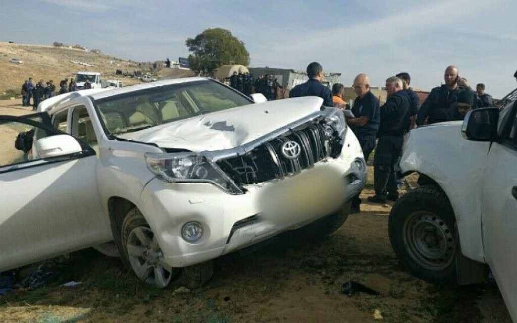 Israeli police stand next to a vehicle that crashed into police officers in the Bedouin village of Umm al-Hiran in the Negev desert, January 18, 2017. (Israel Police)
