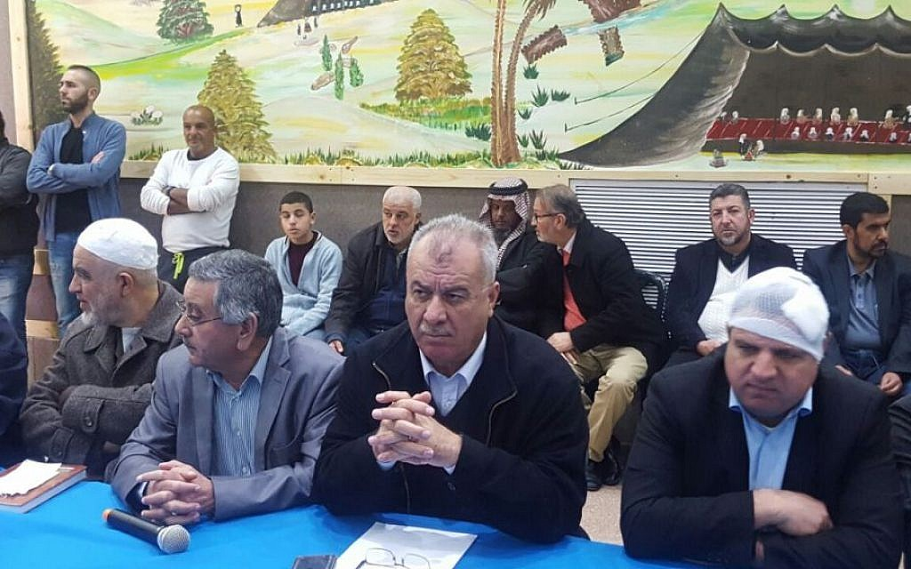 Joint List MKs Ayman Odeh (R) and Jamal Zahalka (2nd R) attend a meeting of the High Follow-Up Committee for Arab Citizens of Israel in Rahat on January 19, 2017 (courtesy)