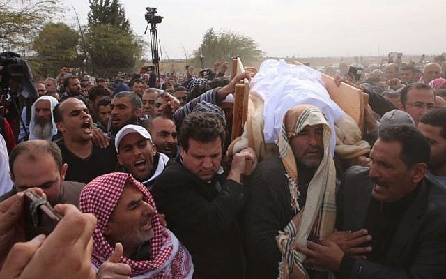 Joint (Arab) List leader MK Ayman Odeh holds the body of Yaqoub Mousa Abu Al-Qia'an, in a funeral that took place on January 24, 2017, near the village of Umm al-Hiran. (Joint List Spokesperson)