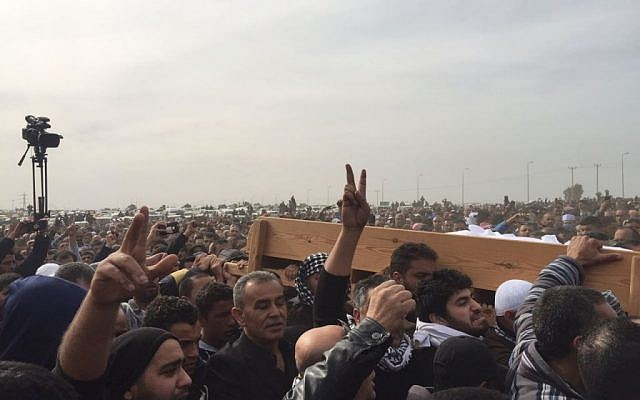 Mourners carry the coffin of Yaqoub Mousa Abu Al-Qia'an, from the Bedouin village of Umm al-Hiran, during his funeral near Hura on January 24, 2017. (Courtesy)
