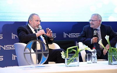 Defense Minister Avigdor Liberman, left, at a INSS conference in Tel Aviv, January 24, 2017 (Hen Galili)