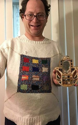 Baltimore knitter Sam Barsky displays his Yom Kippur-themed sweater featuring the High Priest's breastplate. (Courtesy/Facebook)