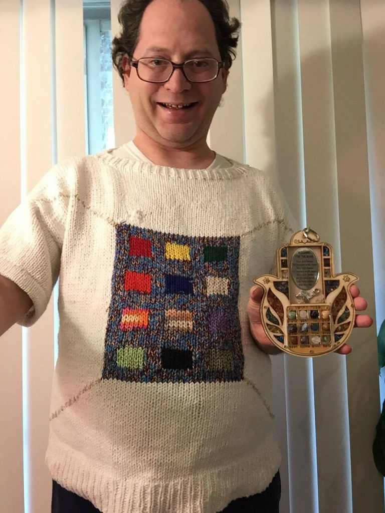 759e79114 Baltimore knitter Sam Barsky displays his Yom Kippur-themed sweater  featuring the High Priest s breastplate
