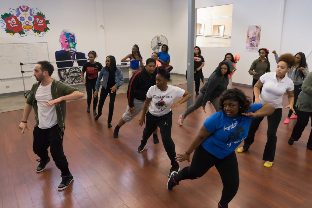 Students pick up some new moves with Yossi Chaikin of the Chicago production of 'Hamilton' at the Little Black Pearl. (Ronit Bezalel/Times of Israel)
