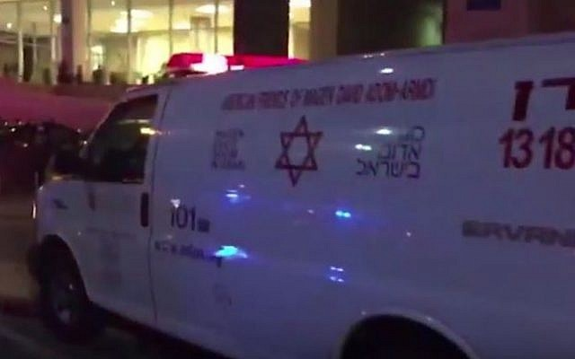 An ambulance at the scene of a double murder in Tel Aviv on January 21, 2017. (screen capture: YouTube)