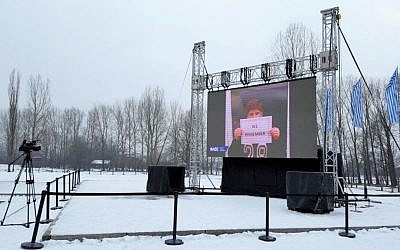 """Image from WJC's """"We Remember"""" campaign projected on screen at Auschwitz-Birkenau Concentration Camp, January 24, 2017 (Courtesy)"""