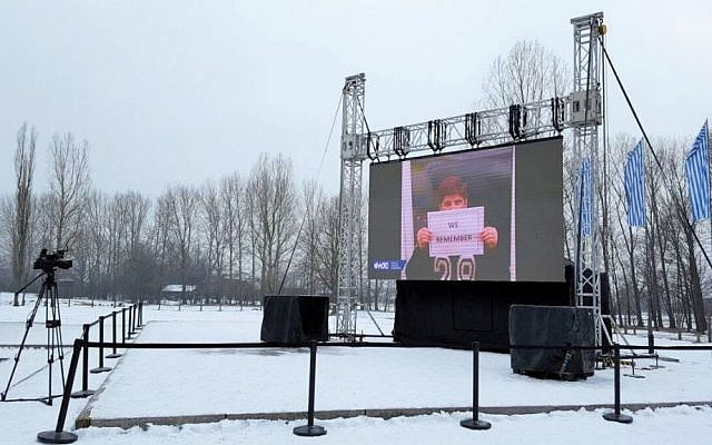 "Image from WJC's ""We Remember"" campaign projected on screen at Auschwitz-Birkenau Concentration Camp, January 24, 2017 (Courtesy)"