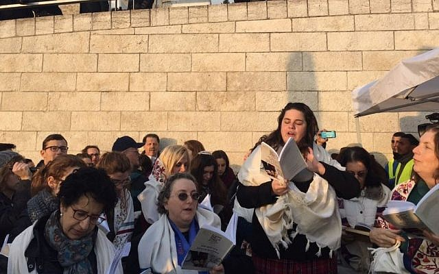 Members of the Women of the Wall group praying outside the entrance to the Western Wall after they were denied entry to the site for refusing to undergo body searches, despite a recent Supreme Court ruling outlawing the searches. January 19, 2017. (Courtesy of Women of the Wall)