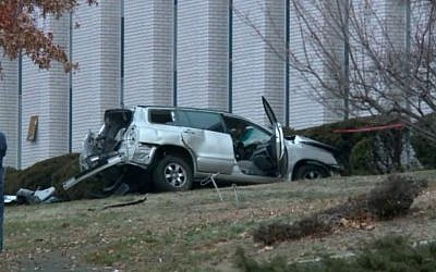 A reportedly stolen SUV that crashed into the side of the Congregation Beth El Keser Israel Synagogue in New Haven, Connecticut on January 2, 2016. (screen capture: FOX 61)