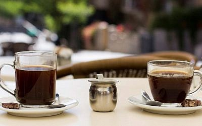 Illustrative photo of two cups of coffee at a cafe in Jerusalem, Israel on July 26, 2015. (Garrett Mills/Flash 90)
