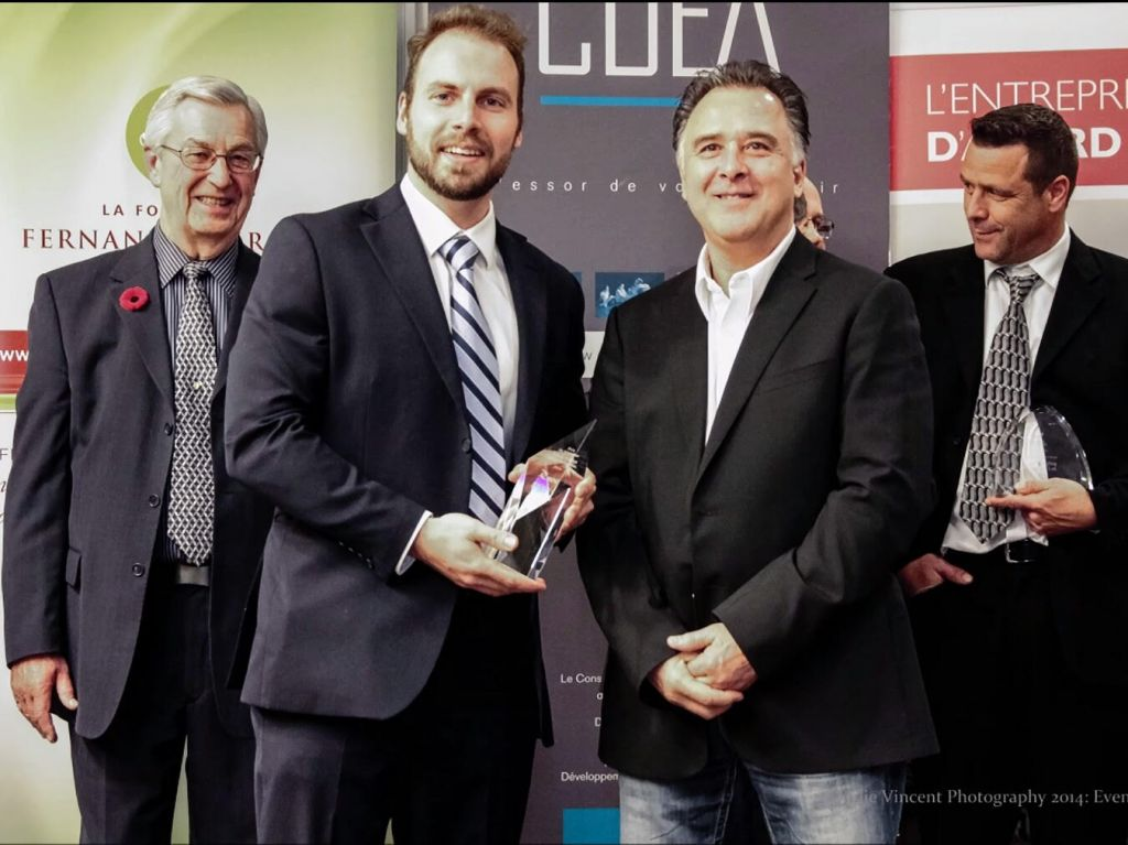 Fred Turbide (right foreground) receiving an entrepreneur of the year award from the French Chamber of Commerce in Alberta (Courtesy)
