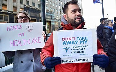 Constituents speak-out and rally supporting the Affordable Care Act, organized by MoveOn.org outside Senator Pat Toomey's office on December 20, 2016 in Philadelphia, Pennsylvania.  (Photo by Lisa Lake/Getty Images for Moveon.org/ via JTA)