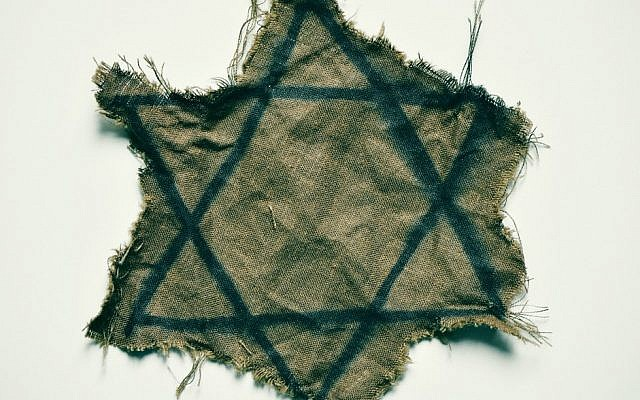 Illustrative photo of a ragged yellow Star of David that Jews across Europe were forced to wear during World War II. (Getty images)