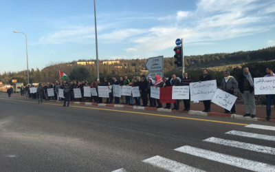 Arab Israelis hold protest banners against the demolition of homes in the unrecognized Bedouin village of Umm al-Hiran, January 19, 2016. (Courtesy)