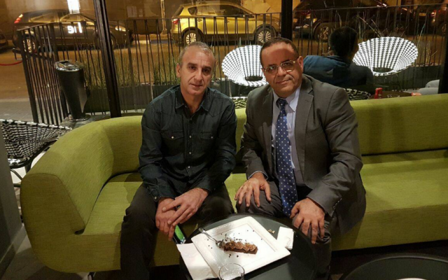 Minister-without-portfolio Ayoub Kara (right) meets with Ilan Hassin, whose son Ben is held in an unnamed Arab state on murder charges. (Screen capture: Facebook)