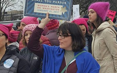 "A Jewish marcher holds a sign proclaiming ""Justice, justice shall you pursue"" during the Women's March on Washington, January 21, 2017. (Rebecca Stoil/Times of Israel)"