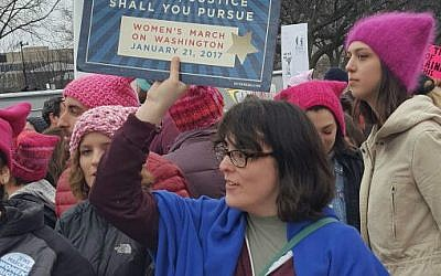 """A Jewish marcher holds a sign proclaiming """"Justice, justice shall you pursue"""" during the Women's March on Washington, January 21, 2017. (Rebecca Stoil/Times of Israel)"""