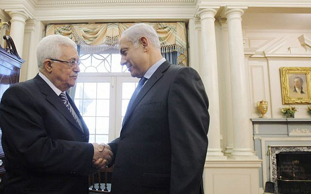 File: Palestinian Authority President Mahmoud Abbas, left, shakes hands with Prime Minister Benjamin Netanyahu before holding direct peace talks at the State Department in Washington, DC, Sept. 2, 2010. (Jason Reed-Pool/Getty Images via JTA)