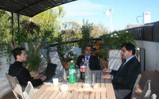 Ronen Bergman (left), Alberto Nisman (center) and Gustavo Perednik, a friend of Nisman's who wrote a 1994 book on the AMIA bombing, photographed at Bergman's home in Israel (Courtesy Ronen Bergman)