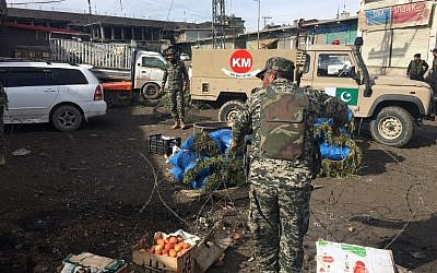Pakistani security officials inspect the site of a bomb explosion at a vegetable market in Parachinar city, the capital of Kurram tribal district on the Afghan border on January 21, 2017.  (AFP PHOTO / ALI JAN)