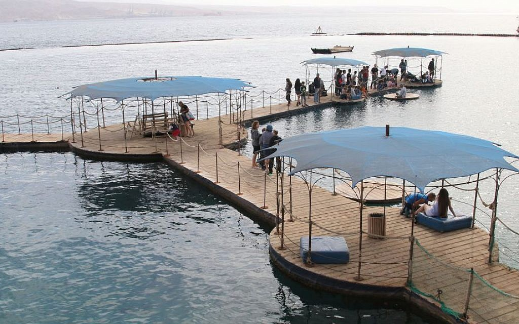 The pier at Eilat's Dolphin Reef, where trainers interact with the dolphins and provide lessons to visitors. (Shmuel Bar-Am)