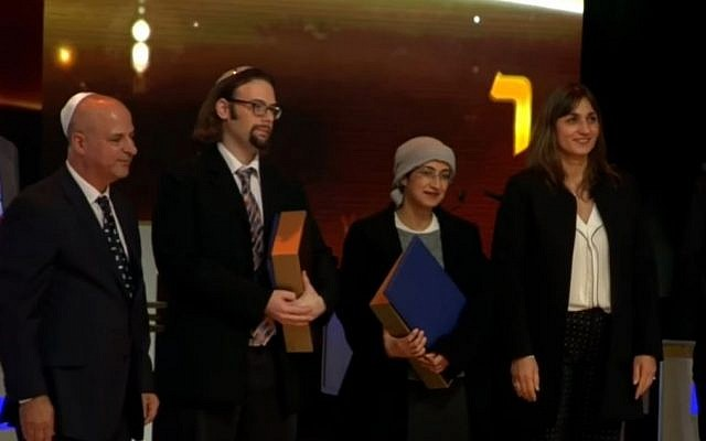 Winners of 2016 Adult International Bible Quiz, Yair Shahak (second from left) and Yafit Silman (second from right), December 28, 2016 (Screen capture: YouTube)