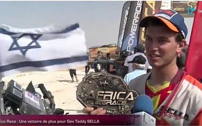 Israeli motorcycle driver Gev Teddy Sella wins the Africa Eco Race on January 14, 2017. (screen capture: YouTube)