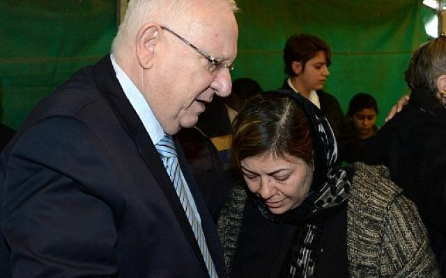 President Reuven Rivlin pays a condolence visit to the family of Lian Zaher Nasser, an Israeli woman killed in a New Year's Day terror attack in Istanbul, on January 5, 2017. (Mark Neyman/GPO)