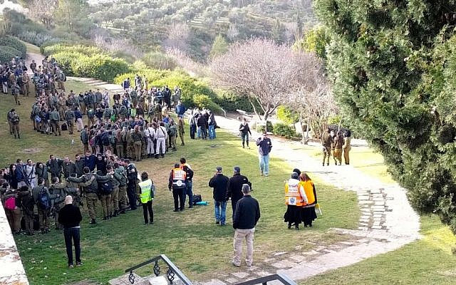 Groups of soldiers receiving psycho-social support following a terror attack on January 8, 2017, on the Haas Promenade in Jerusalem, where a truck rammed into a group of soldiers on a tour. (Melanie Lidman/Times of Israel)