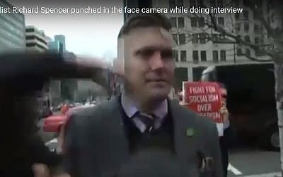 Leader of the so-called alt-right movement, Richard Spencer, is punched in the face during an interview in Washington on January 20, 2017, near where Donald Trump was sworn in as president. Screenshot)